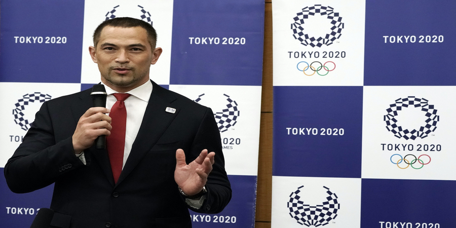 Koji Murofushi, sports director for the Tokyo 2020 Olympic Games, speaks during a medial huddle about his appointment as Japan Sports Agency Commissioner Friday, Sept. 11, 2020, in Tokyo. (AP Photo/Eugene Hoshiko, Pool)
